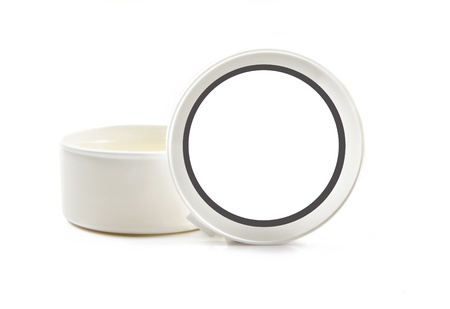 salve: White container with salve or cream on white background