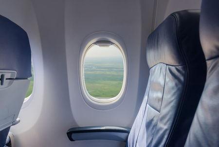 Empty seat airplane and window view inside an aircraft Stock Photo