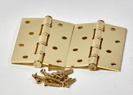 hinged: Hinge closeup isolated on white background Golden Stock Photo