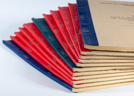 old books of the accountants stack, on a white background Imagens