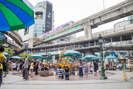 phrom: Bangkok, Thailand - July 14, 2017 : Many people come to Erawan Shrine for pray and worship at Erawan Shrine at Ratchaprasong Junction.