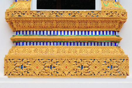 exquisite fairy: Close up pattern of base of windows Thai Buddhist church in Chiang Mai Thailand.