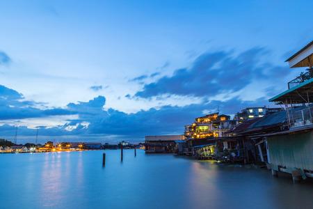 Riverside community at Chao Phraya River, Bangkok Thailand at evening.