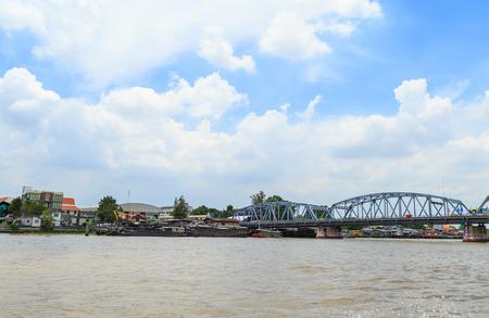 The Sand tankers ship docking at Construction site at Chao Praya river in Bangkok.