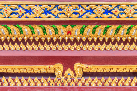 exquisite fairy: Close up pattern of Lai Thai on the base Thai Buddhist church in Bangkok Thailand.