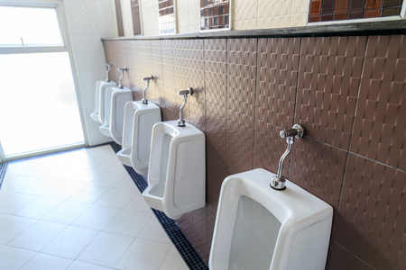 The line of urinall in the mens toilet. Stock Photo
