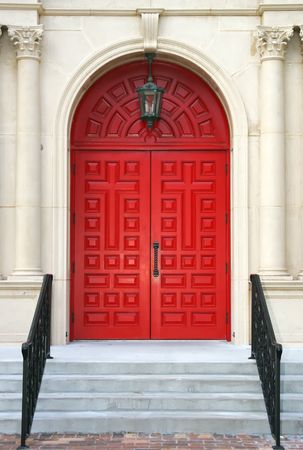 double cross: Ornate Double red church doors with a cross carved in them Stock Photo