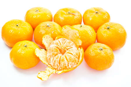 small oranges isolated on white background