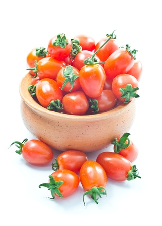 Cherry tomatoes in bowl isolated  photo
