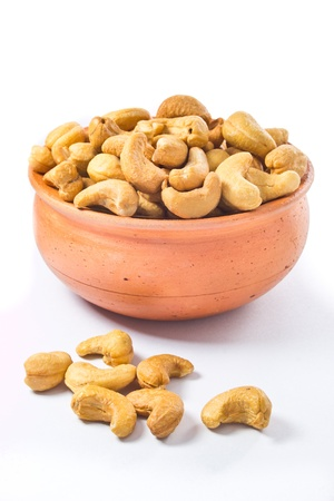 cashews nut in bowl on white background  Stock Photo - 17860770