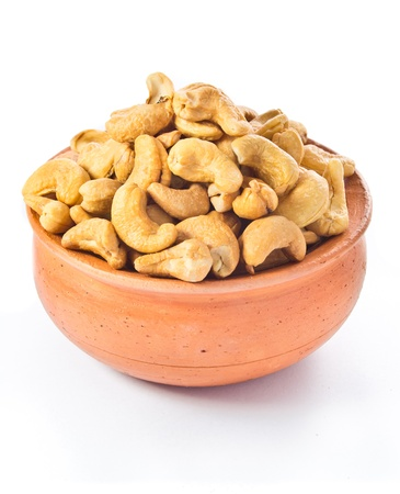 cashews nut in bowl on white background  photo
