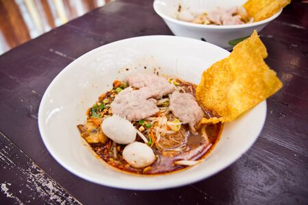 hot and Spicy noodle soup with fish ball  photo