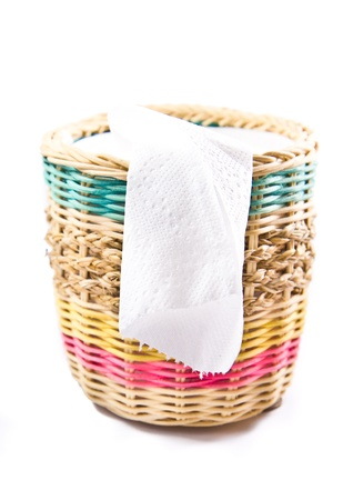 close up of white toilet paper in colorful box on white background