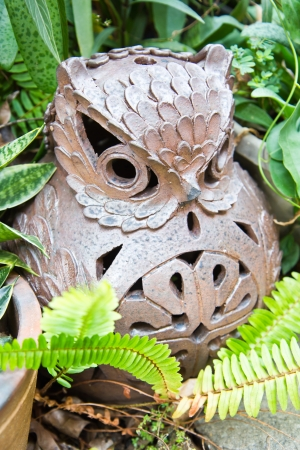 owl ceramic in garden photo