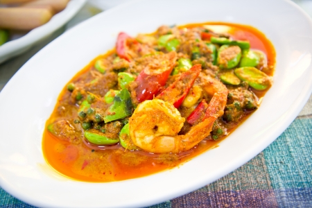 prawn in spicy curry on white plate