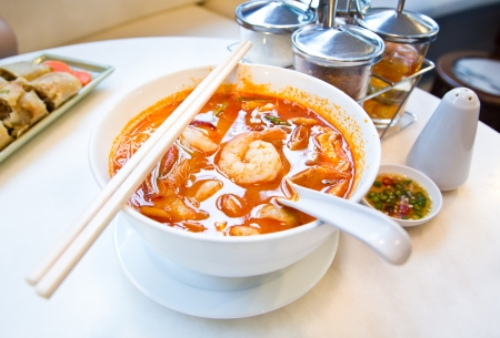 Seafood Noodle in spicy soup  photo