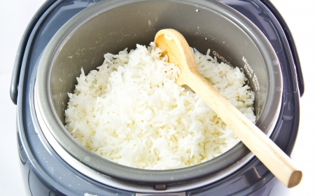 stream rice in electric rice cooker isolated on a white background