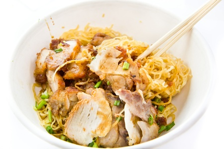 Chinese noodle with pork in bowl photo