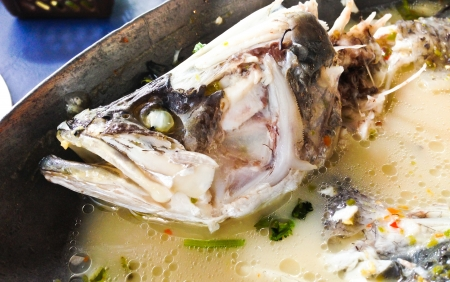 steam mouth: Steamed fish ginger on iron bowl