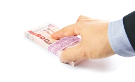 Hand holding a bulk of 100 baht Thailand banknote