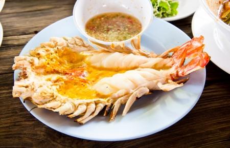 Grilled fresh big shrimp ( Macrobrachium rosenbergii) at Thailand seafood restaurant. Stock Photo