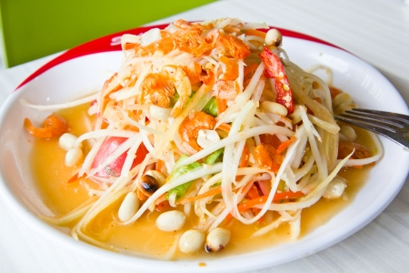 Thai cuisine - hot and spicy papaya salad photo