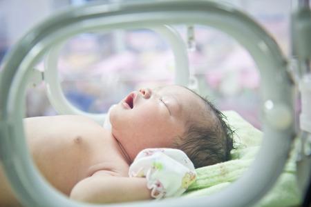 保育園で保育器ケア新生児 写真素材