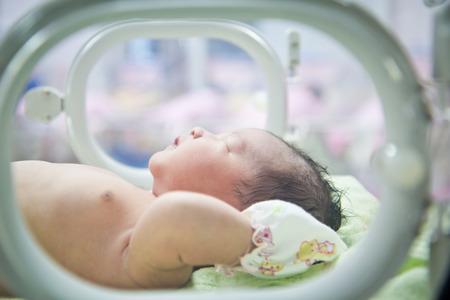 newborn baby in Incubator care at nursery