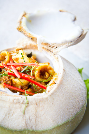 gung: red curry seafood in coconut fruit, Thai food Stock Photo