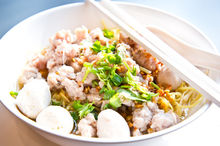 bowl of egg noodles with minced prok and fish balls Stock Photo