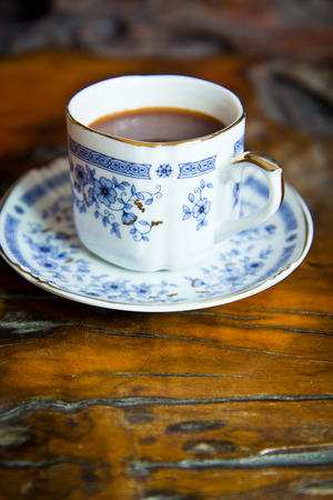 cup of coffee on the wooden table Stock Photo