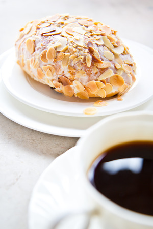 cobnut: bread with almond slices pile on top and cup of coffee