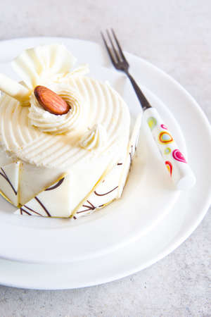 white chocolate cake with almond on top Stock Photo