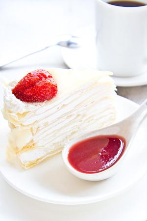 Crape cake with strawberry sauce