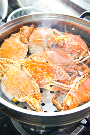 Crabs stream cooking in kitchen Stock Photo