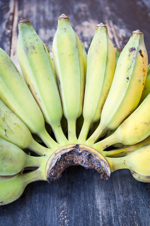 Cultivated bananas on wooden table Stock Photo