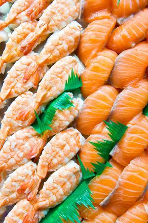 row of shushi fresh shrimp and salmon