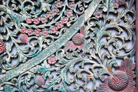 Antique art on wooden gate,Bangkok Thailand photo