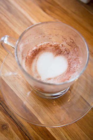 kafe: Finish a cup of cappucino with heart shape on bubble milk