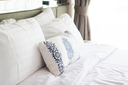bedspread: Design of the white  pillow covers on the  double bed Stock Photo