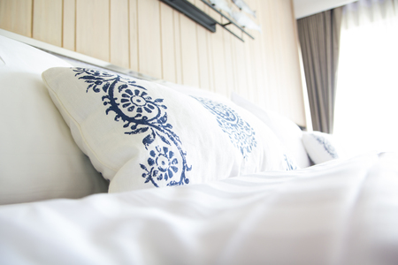 bedder: Design of the white  pillow covers on the  double bed Stock Photo