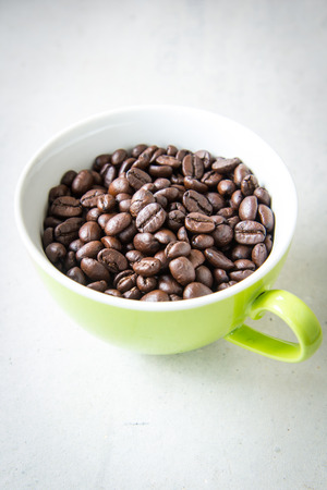 Roasted coffee in green cup
