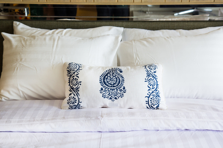Design of the white  pillow covers on the  double bed Stock Photo