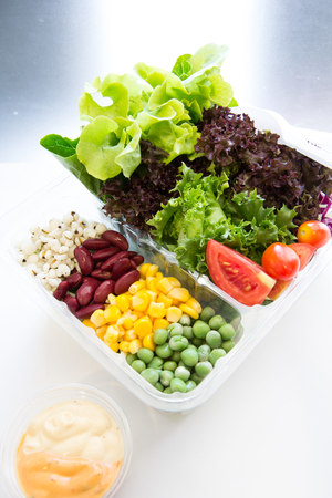 take away salads on white. Includes green salad, garden salad, greek salad and ingredients Stock Photo