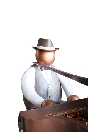 Fat man toy playing paino instrument on white background isolated Stock Photo