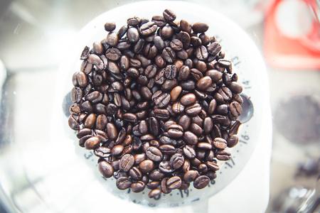grind: Coffee beands inside a grind machine