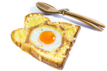 Cooked egg on bread with bacon isolated on white background