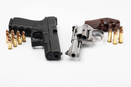Revolver gun and Semi automatic handgun with bullets on white background