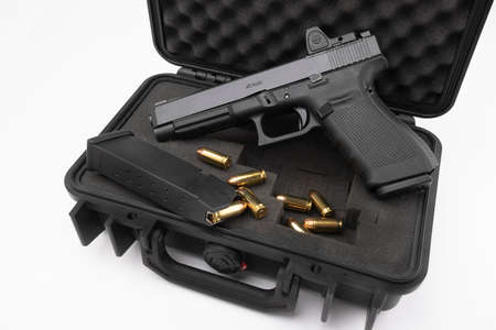 Automatic gun and bullets in a plastic hard case on white background Stock Photo