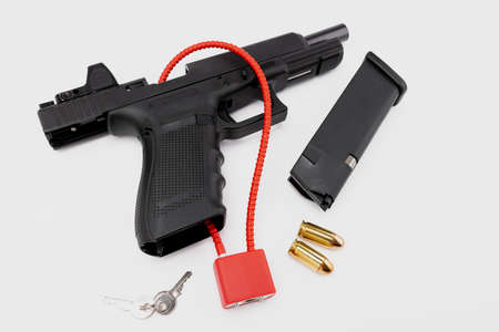 Locked disarmed and secured automatic gun on white background